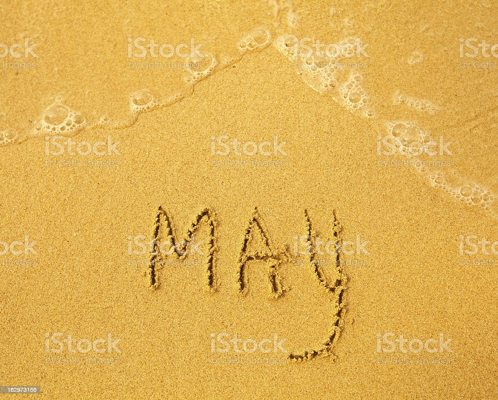May - written in sand on beach texture royalty-free stock photo