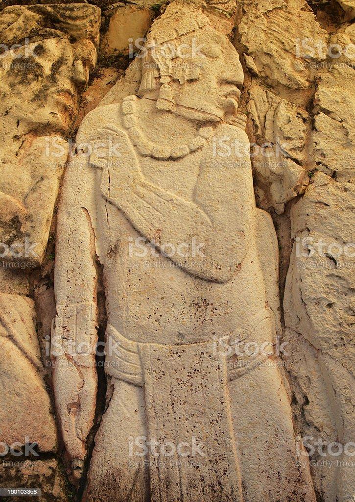 Mayan captive, immortalized in limestone stock photo