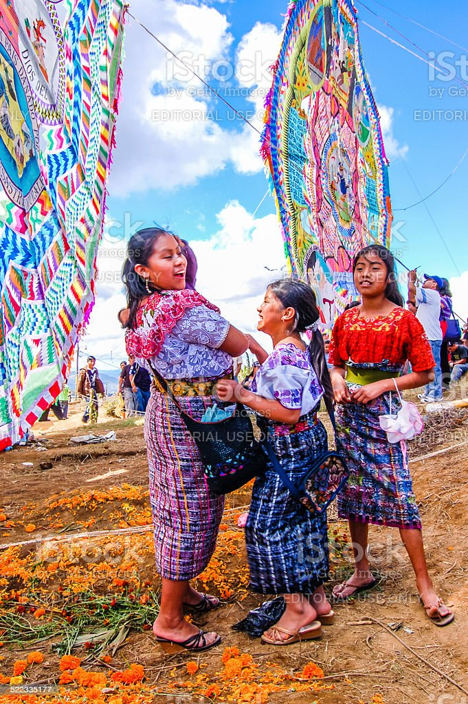 Mayan girls & giant kites, All Saints' Day, Guatemala stock photo