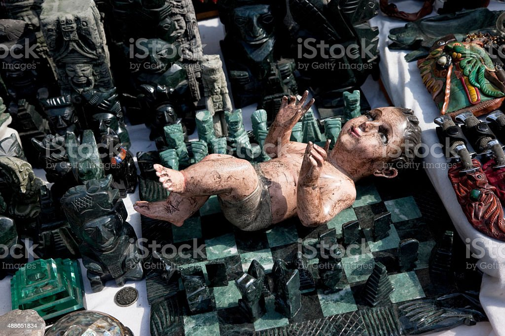 Mayan Gods and baby Jesus on sale on open market stock photo