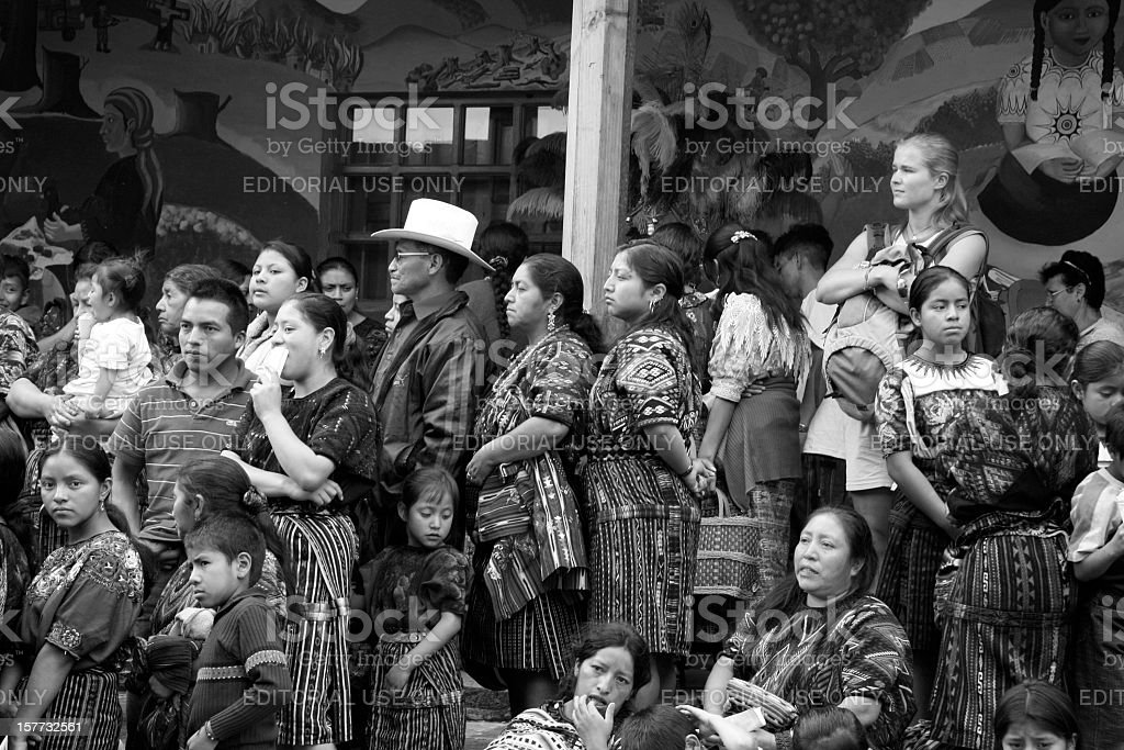 Mayan people watching parade in Chichicastenango on All Saints day stock photo