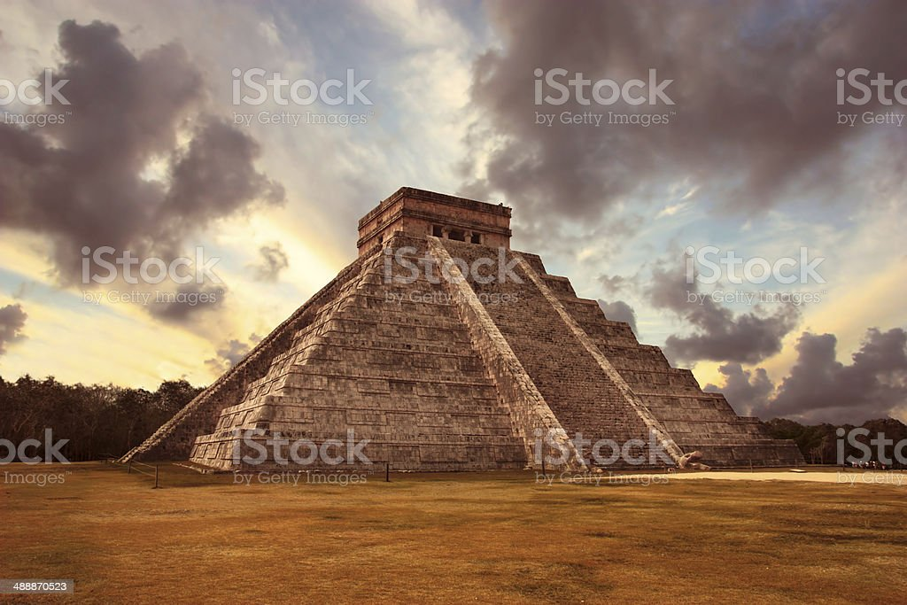 Mayan pyramid in Chichen Itza under a cloudy sky stock photo