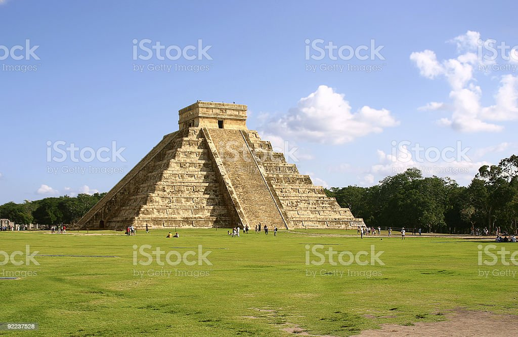 Mayan pyramid with people standing around it stock photo