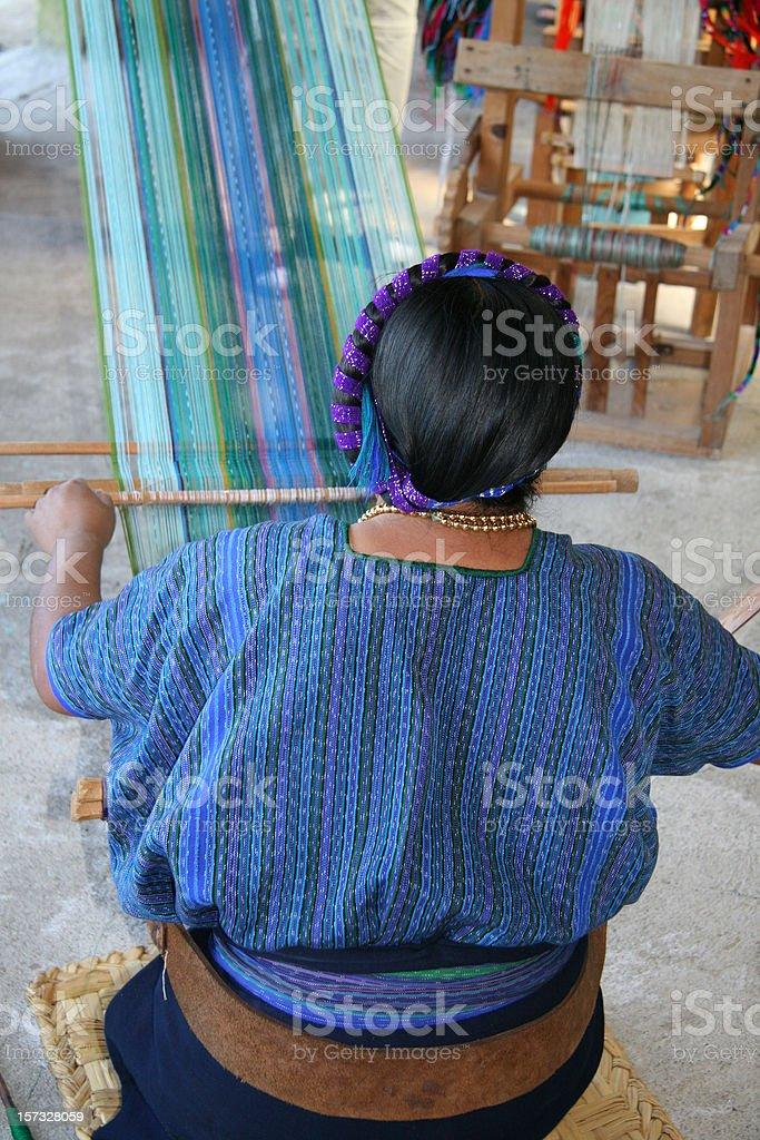 Mayan woman weaving in village by lake Atitlan, Guatemala stock photo