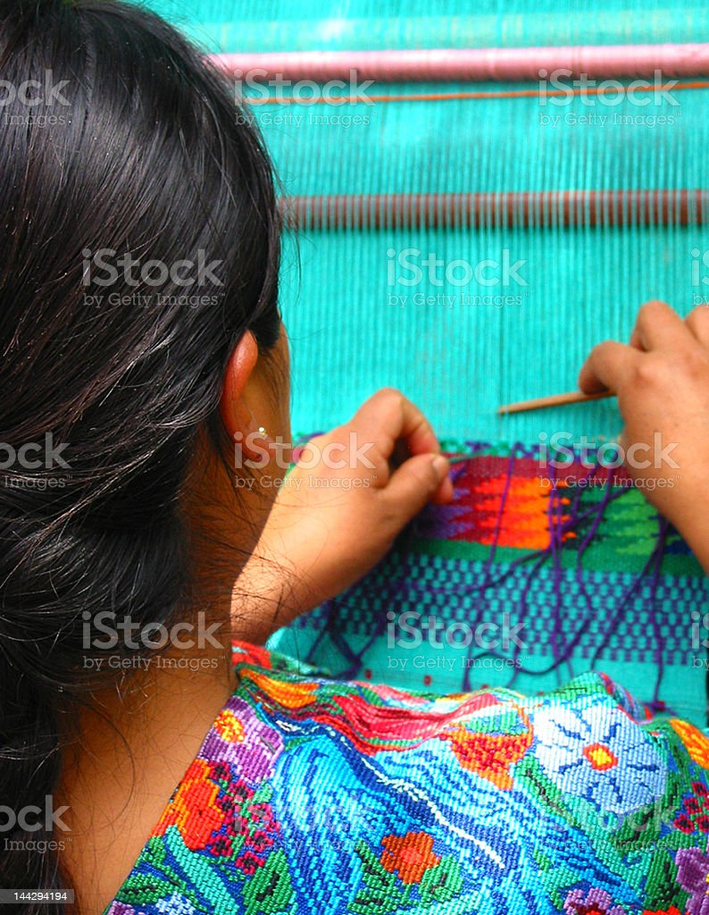Mayan woman weaving stock photo