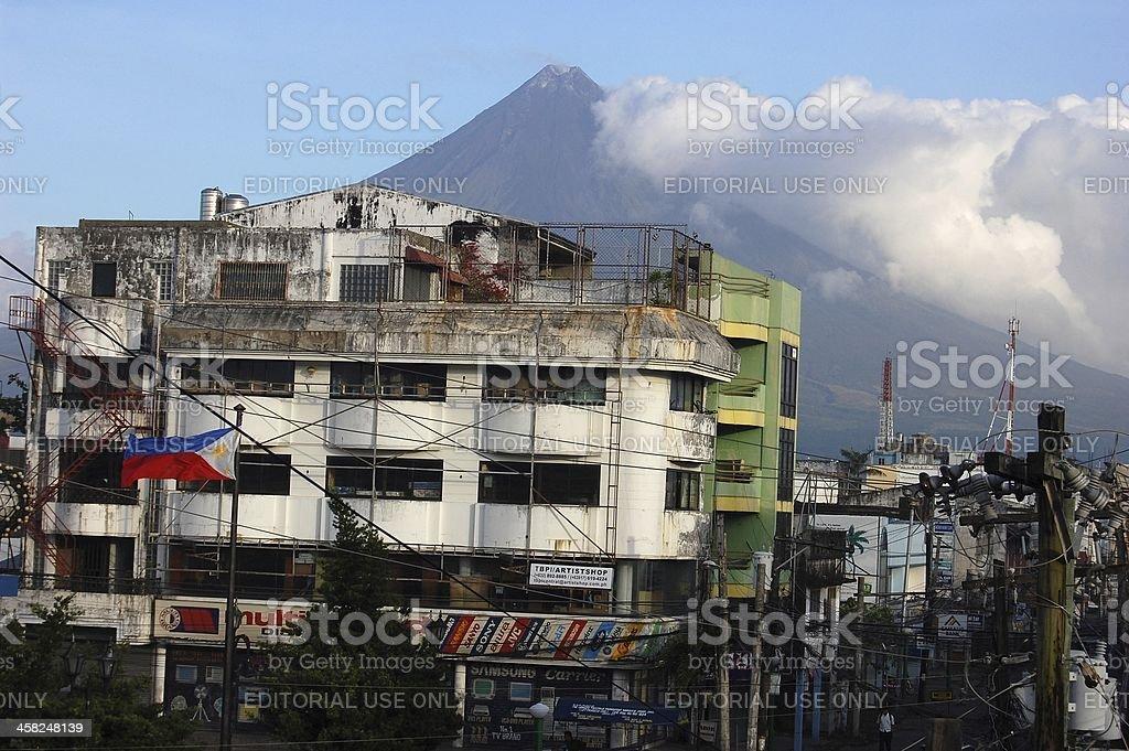 Mayon volcano perfect cone rise over Legazpi city, Philippines stock photo
