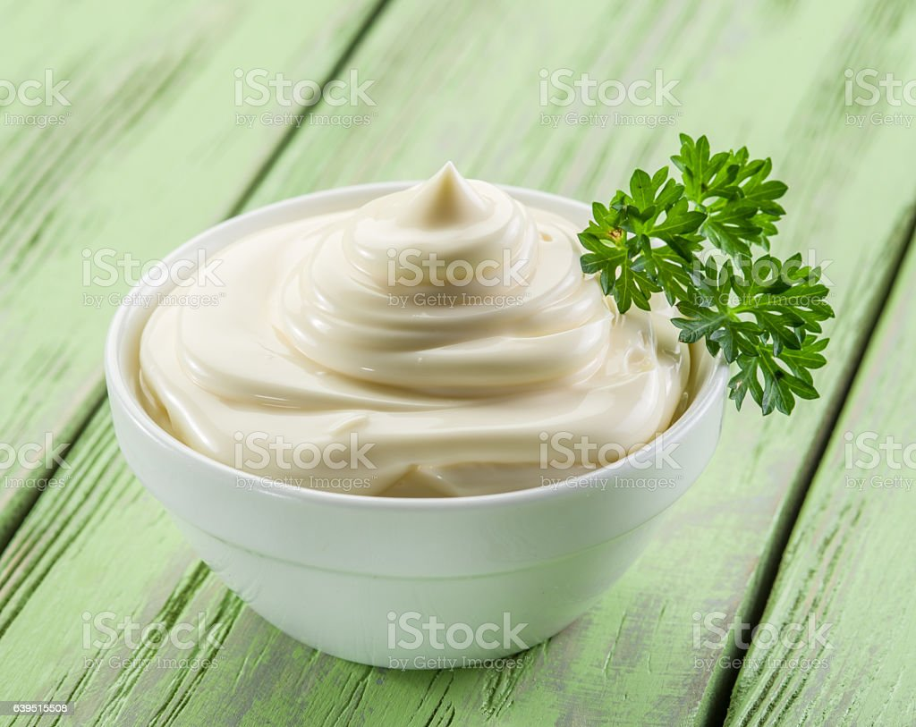 Mayonnaise in the white bowl. stock photo