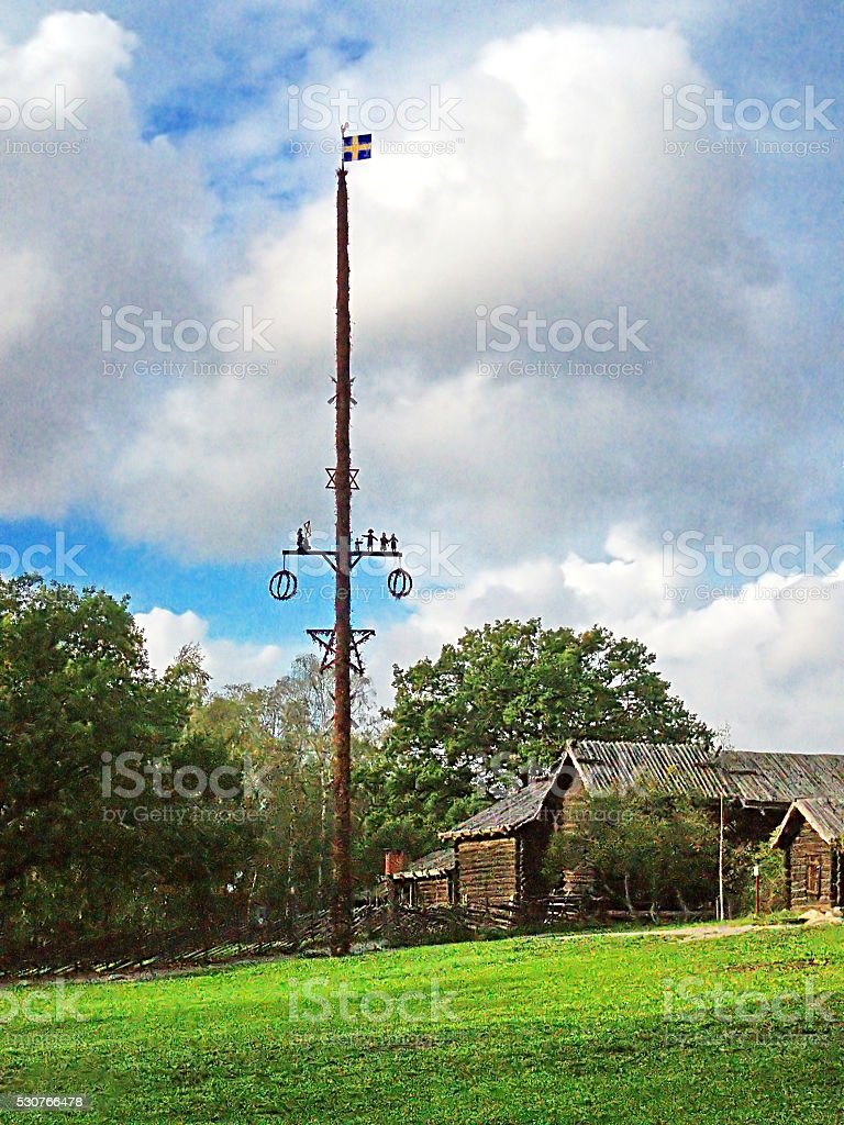 Maypole and Swedish flag in Skansen, Stockholm, Sweden stock photo