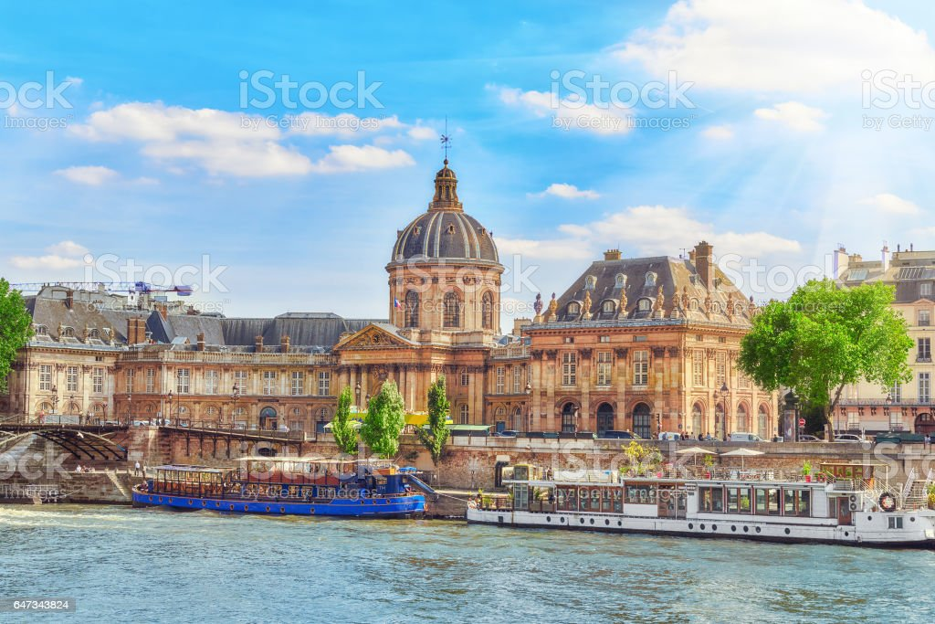 Mazarin Library (Bibliotheque Mazarine) and  Bridge of the Arts ( Pont des Arts) in Paris. France. stock photo