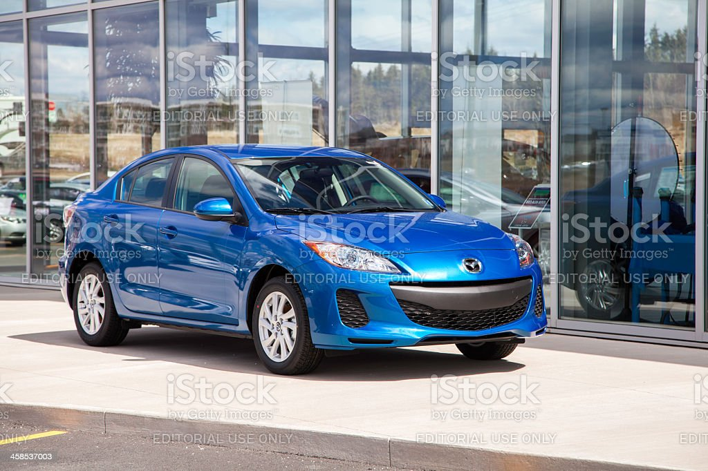 Mazda 3 in Front of Dealership royalty-free stock photo