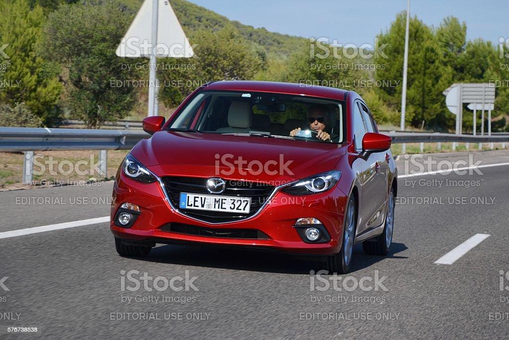 Mazda 3 on the highway stock photo