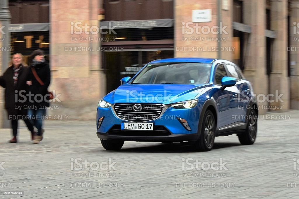 Mazda CX-3 driving on the street stock photo