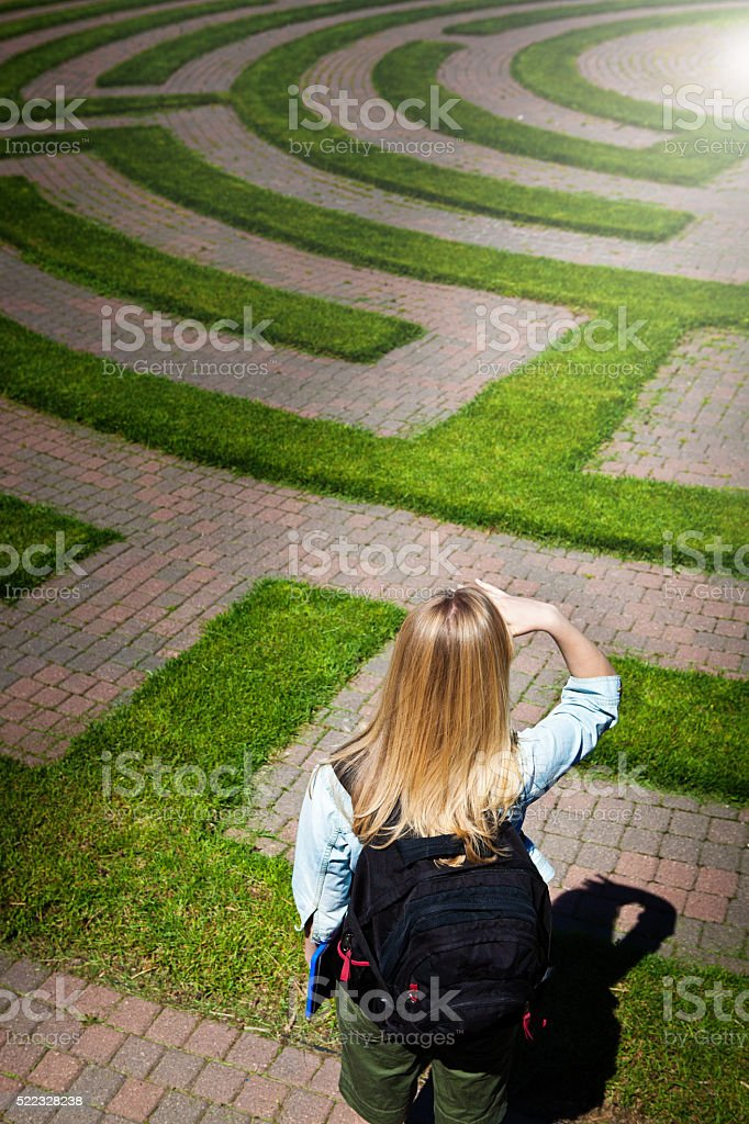 Maze Footpath with Woman Teenager Student Forecasting the Way Forward stock photo