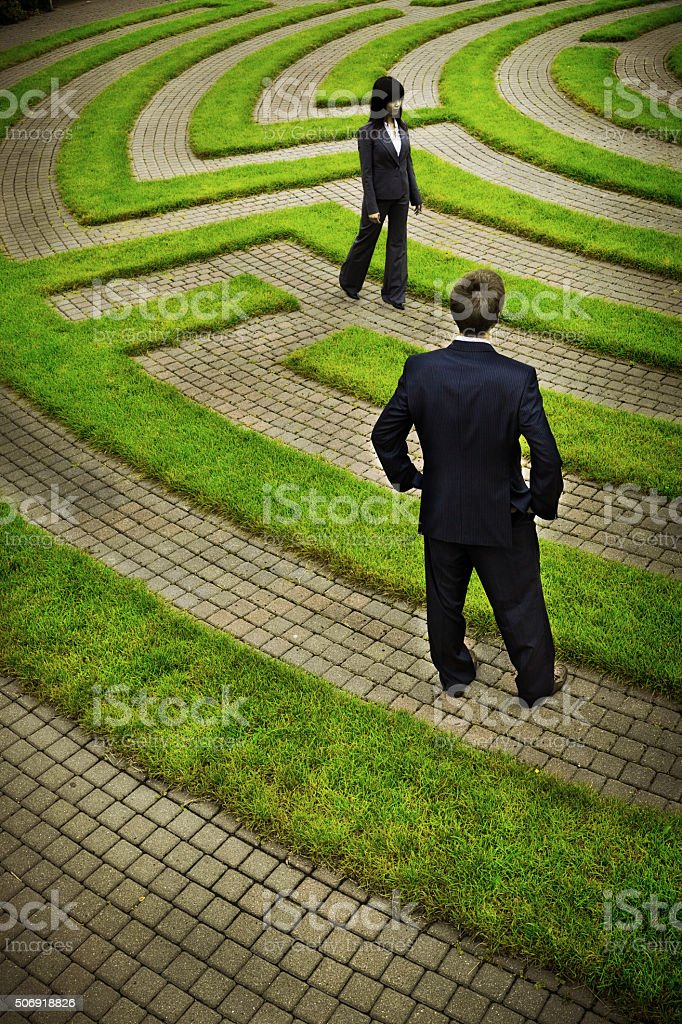 Maze with Confused Business People Searching Path for Strategy, Solutions stock photo