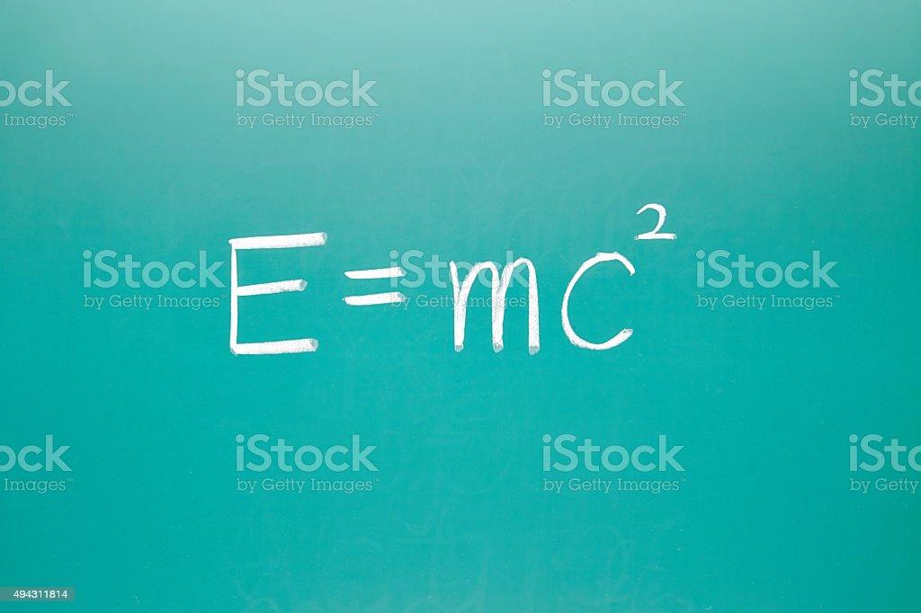 E=mc² physical formula on blackboard stock photo