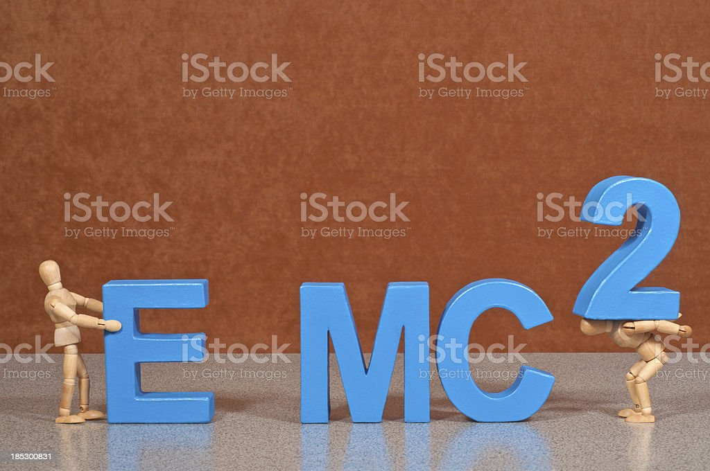 E=mc2 - Wooden Mannequin demonstrating this word royalty-free stock photo