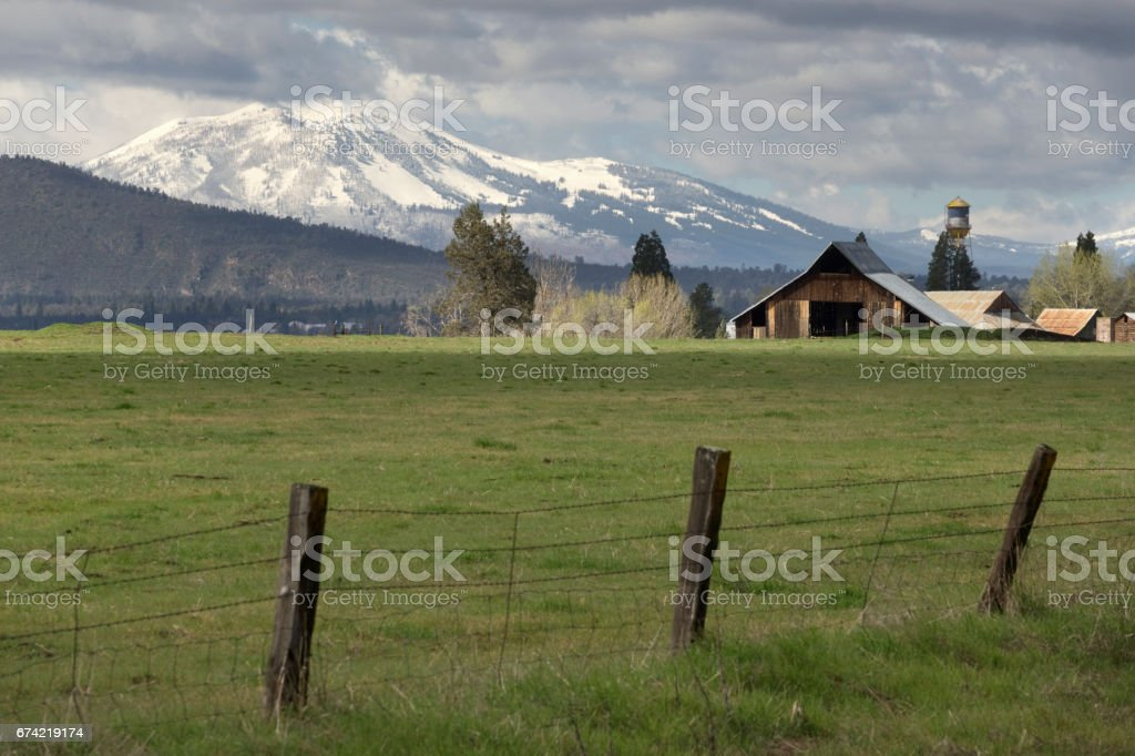 McArthur California farm barn snowy Crater Peak volcano Lassen National Forest stock photo