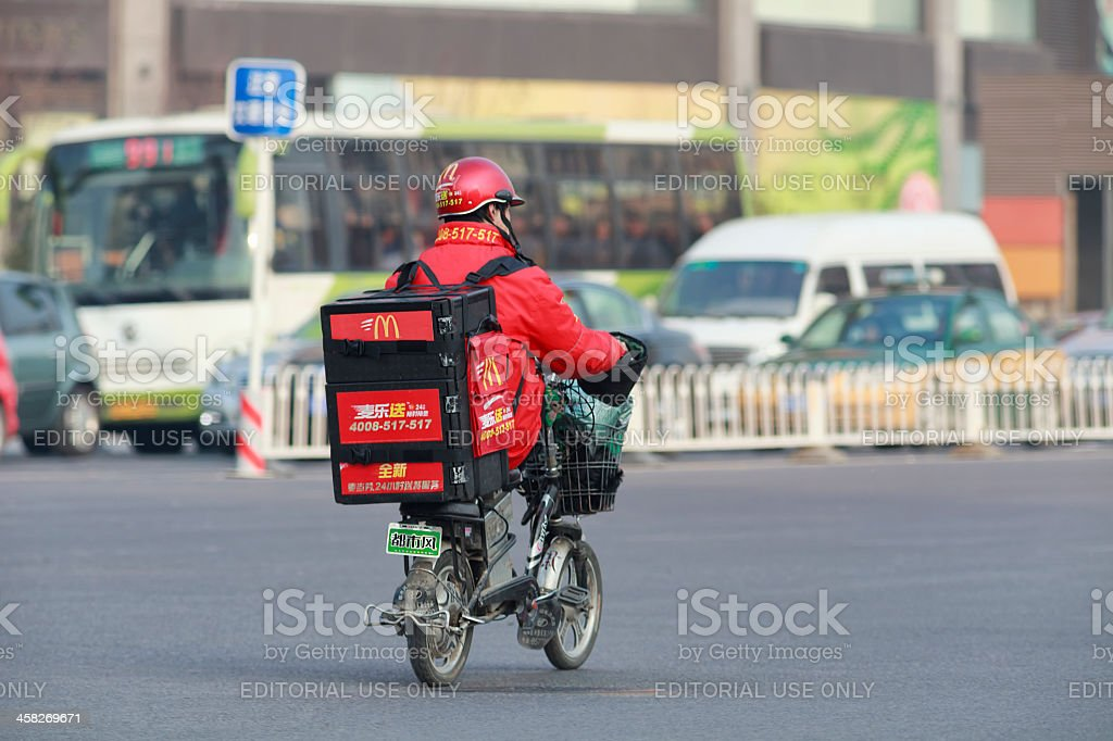 McDonald delivery on an E-bike in Beijing royalty-free stock photo