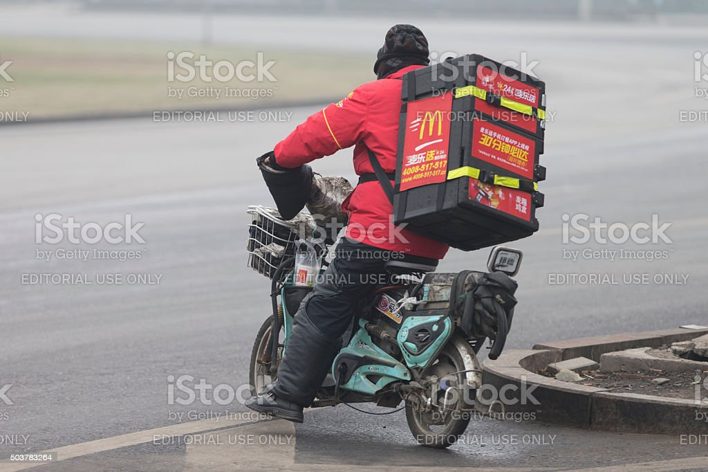 McDonald delivery on an electric bicycle in Beijing stock photo