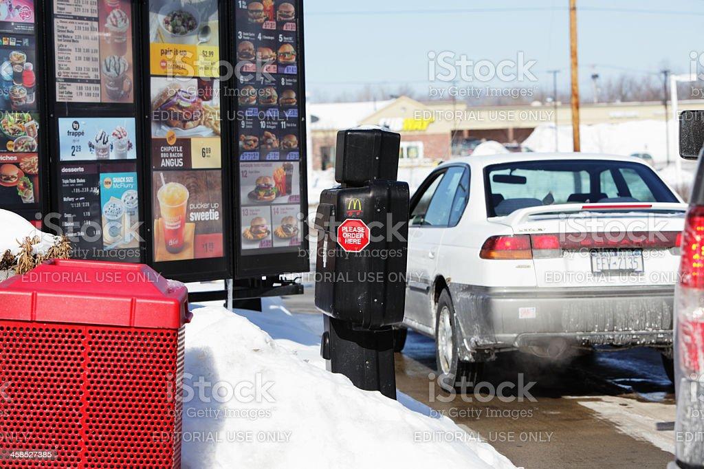 McDonald's Drive Thru Cars Waiting in Winter stock photo