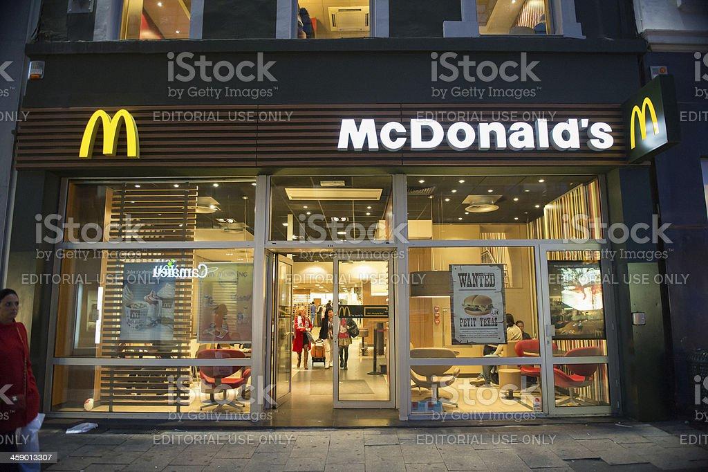 McDonald's restaurant at night in Brussels, Belgium royalty-free stock photo