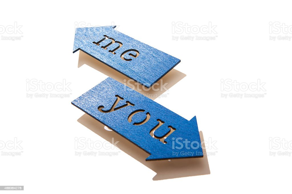Me and You on arrows pointing different directions stock photo