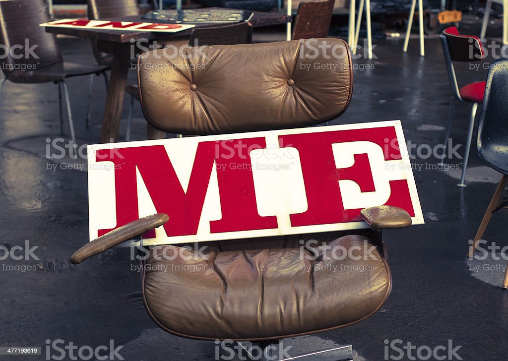 'Me' written on a white board over an office chair stock photo