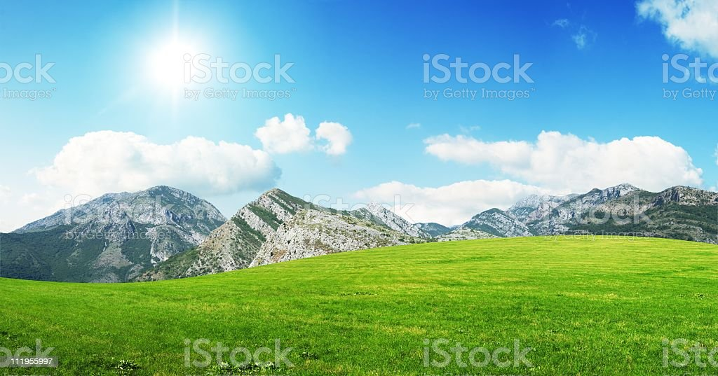 Meadow and mountains royalty-free stock photo