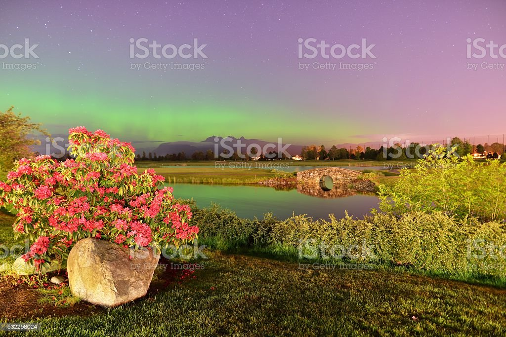 Meadow Gardens Golf Field and Golden Ears Mount With Aurora stock photo