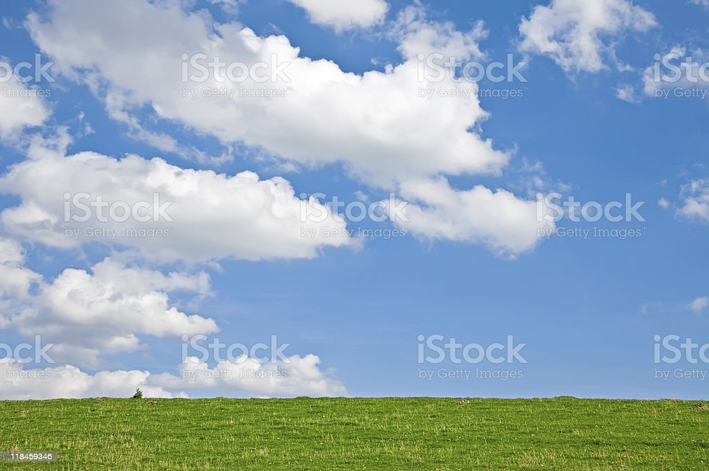Meadow with Clouds stock photo