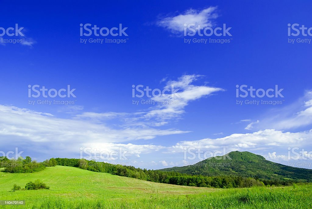 Meadow with clouds. royalty-free stock photo