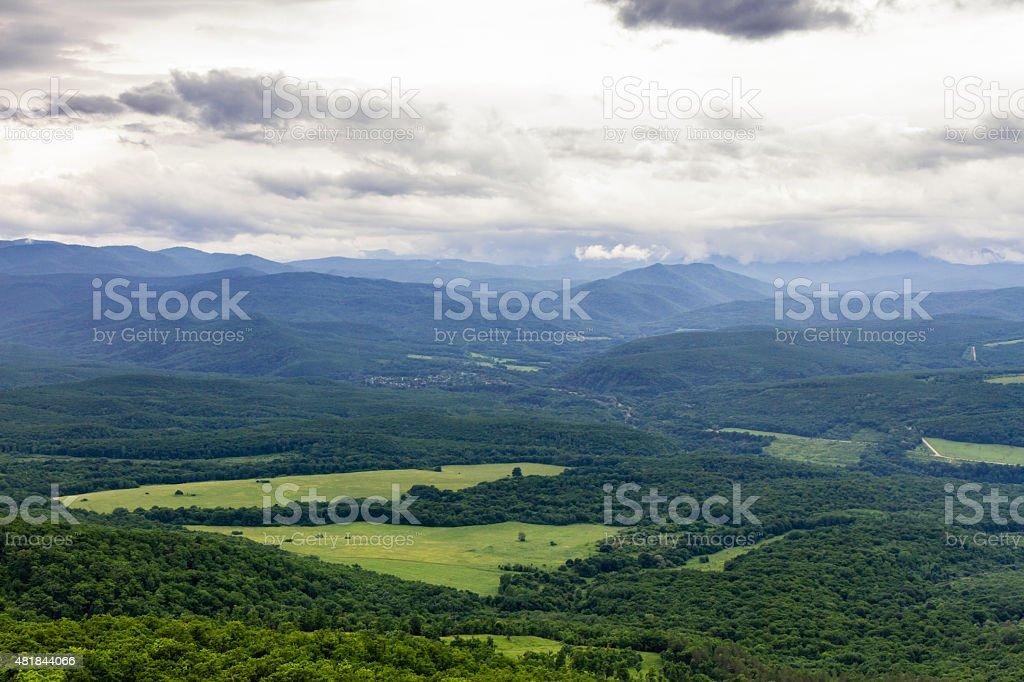 Meadows in a mountain valley stock photo