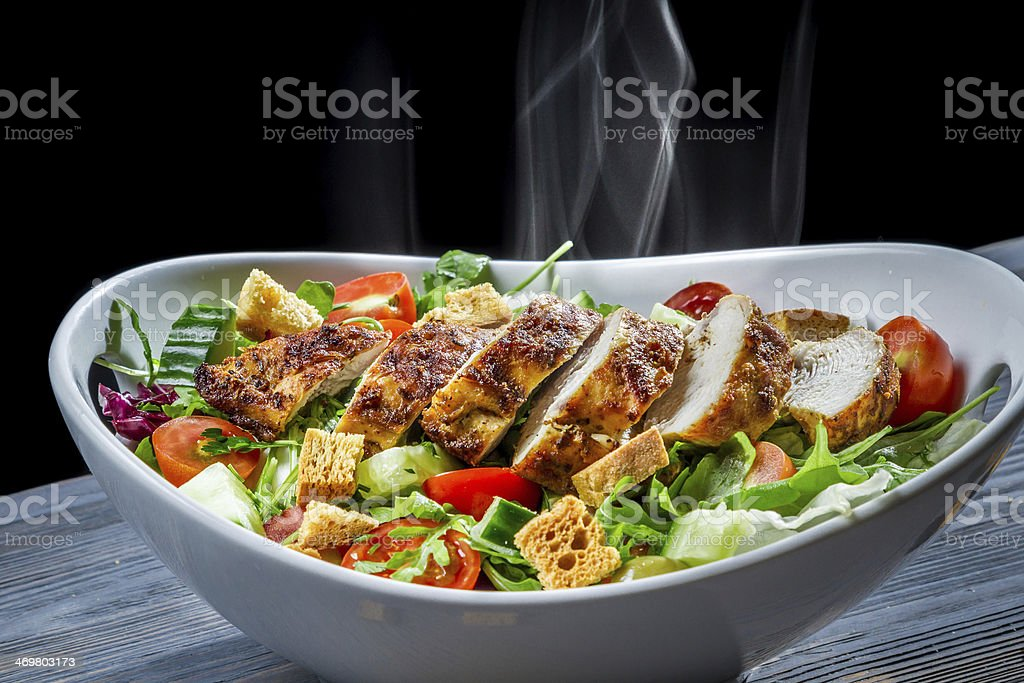 Meal consisting of grilled chicken pieces and salad stock photo
