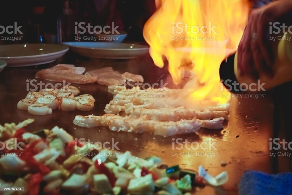Meal cooked in front of guests at Teppanyaki restaurant stock photo