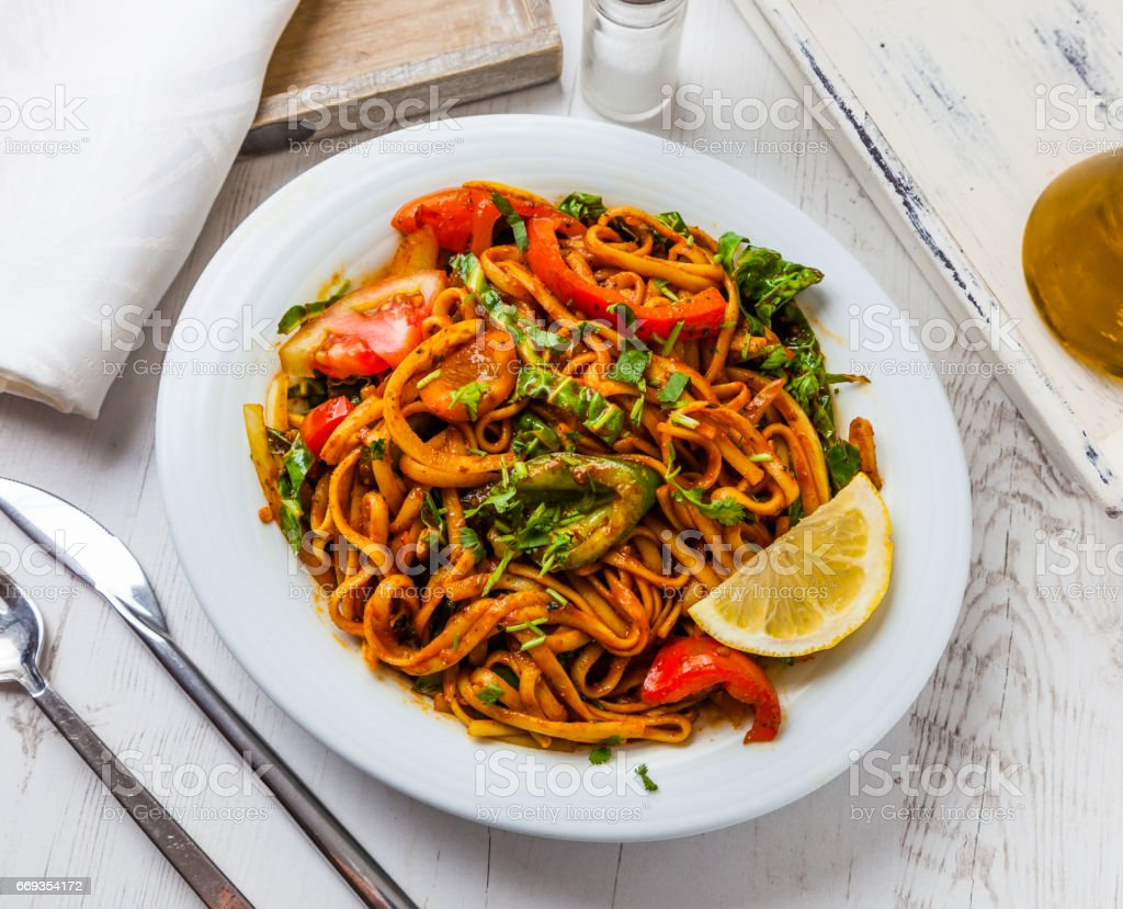 A meal of vegetarian stir-fried chow mein. stock photo