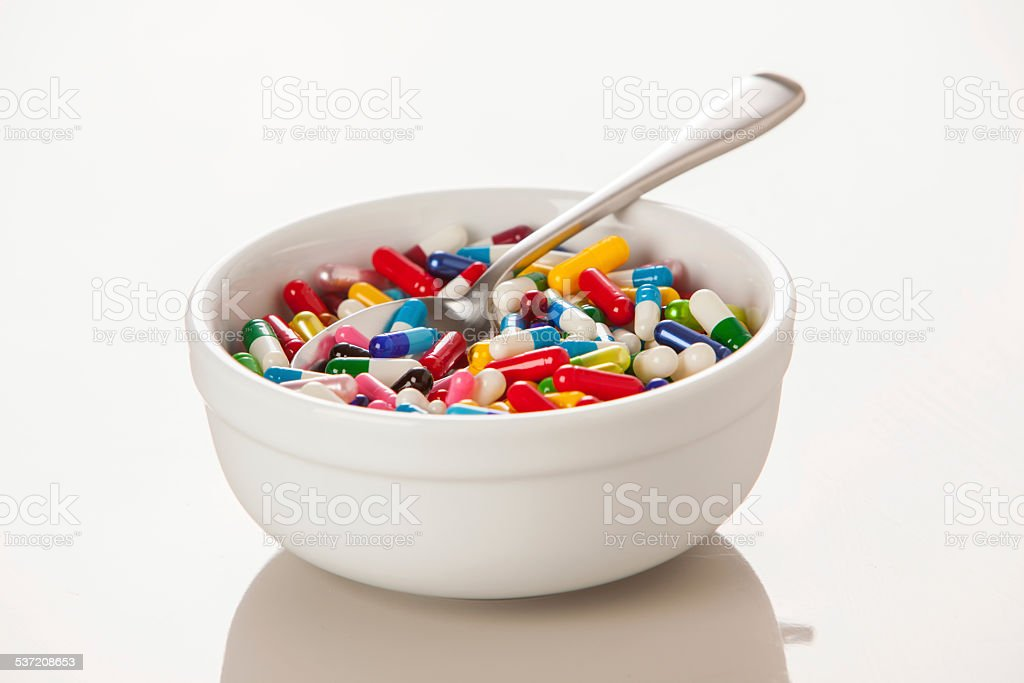 Meal replacement bowl full of capsules stock photo