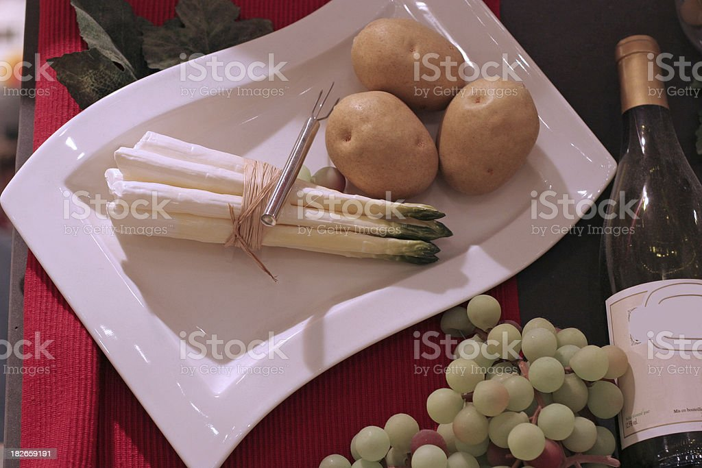 Meal with asparagus, potatoes and wine royalty-free stock photo