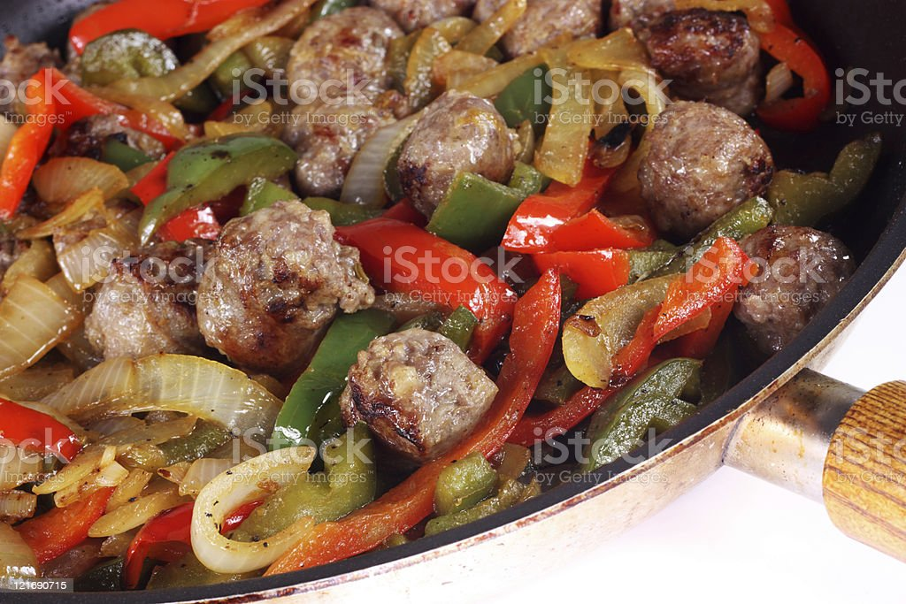 Meal with beef, sausage, onions and peppers stock photo