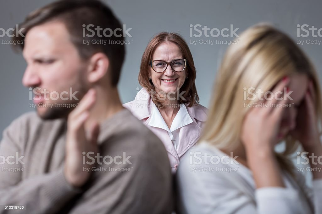 Mean and intrusive mother stock photo