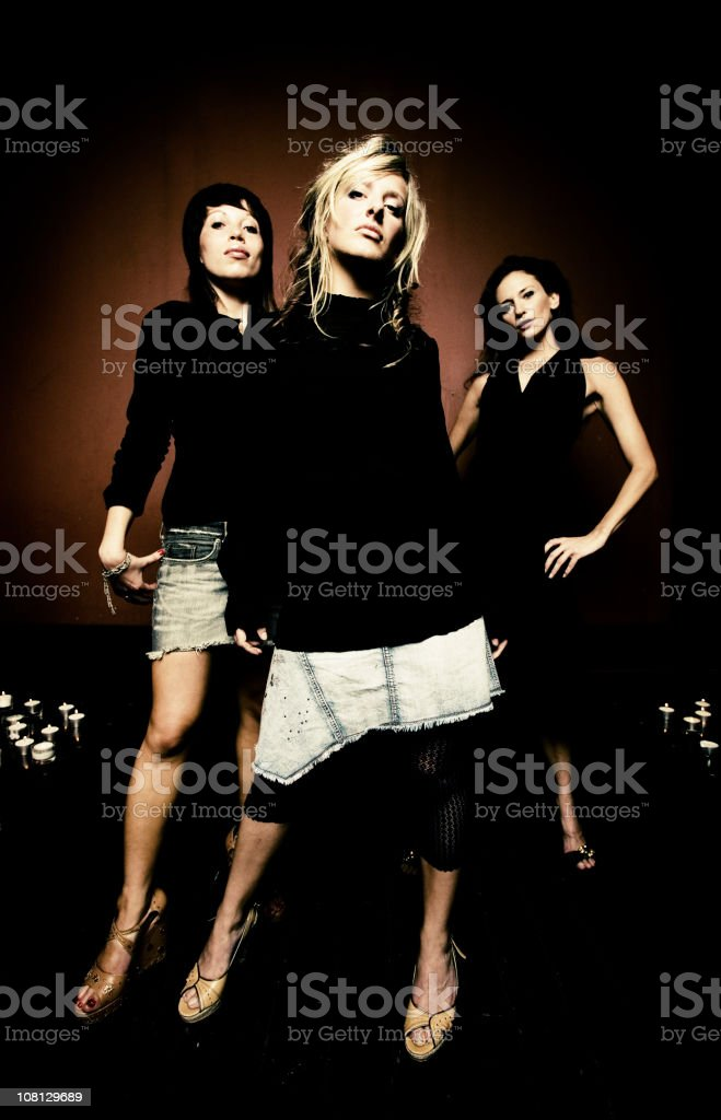 Mean and moody fashion portrait with 3 urban female models royalty-free stock photo