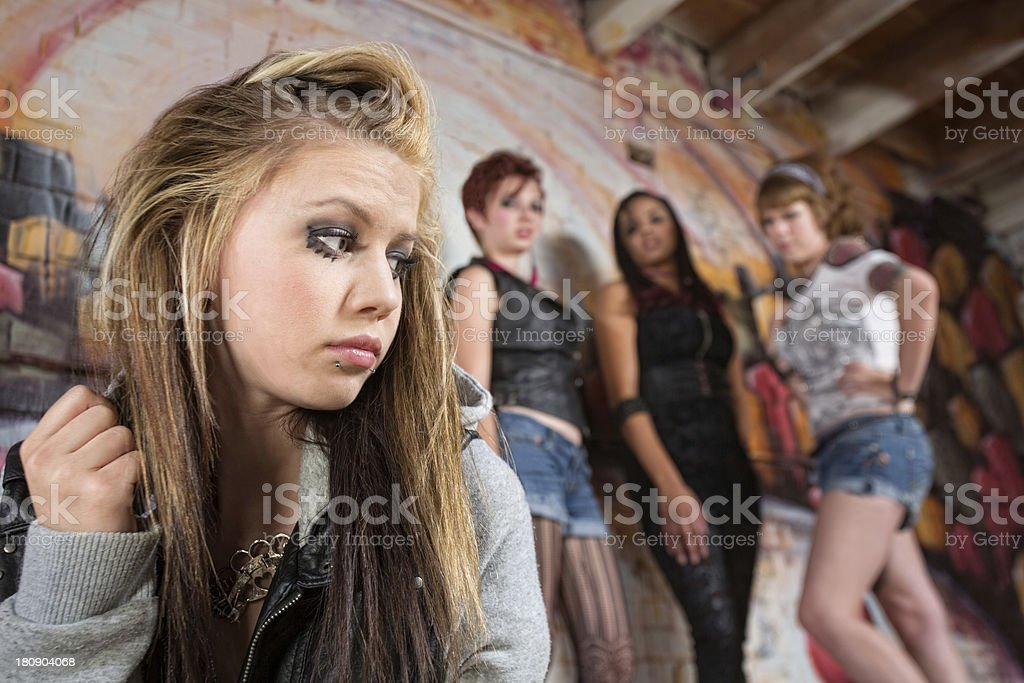 Mean Group Near Sad Girl royalty-free stock photo