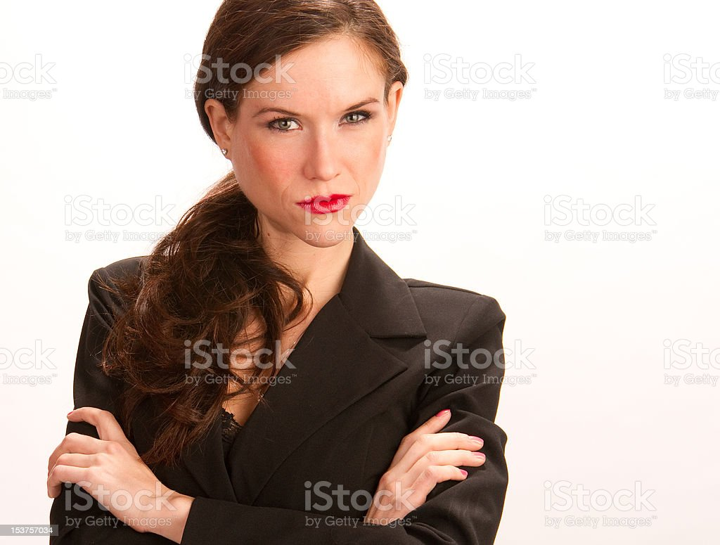 Mean Looking Business Woman Arms Crossed Standing on White stock photo