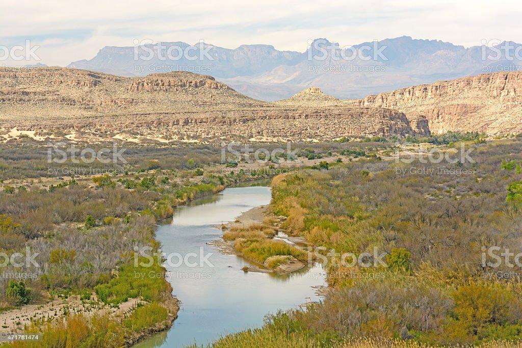Meandering River Through a Desert Canyon stock photo