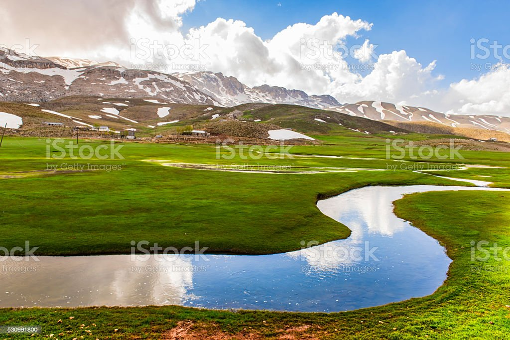 meandering waters in the snowy mountains stock photo