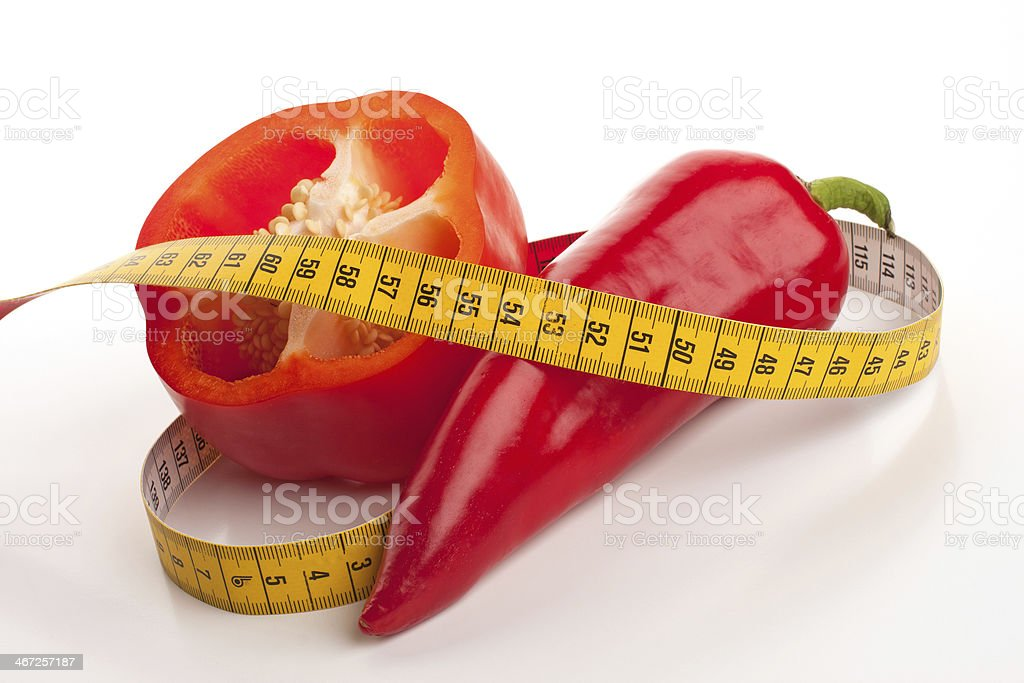 Measirung tape and red peppers royalty-free stock photo