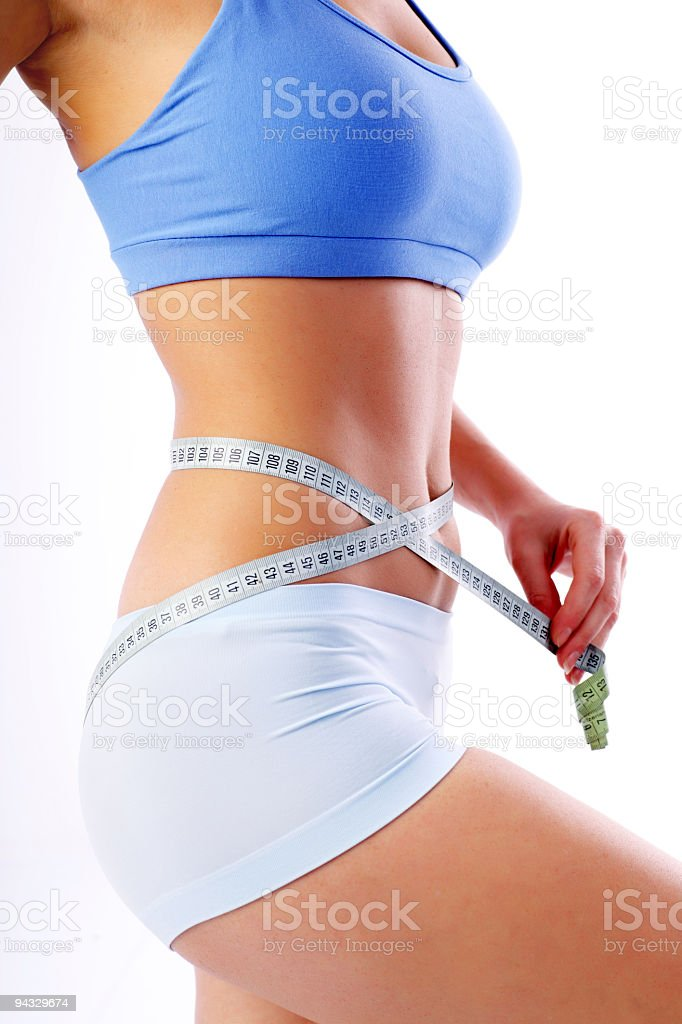 Measure tape around slim beautiful waist. royalty-free stock photo