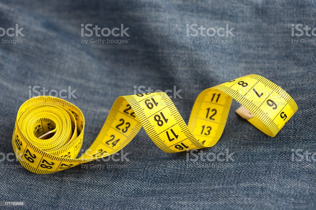 Measure tape on jeans royalty-free stock photo