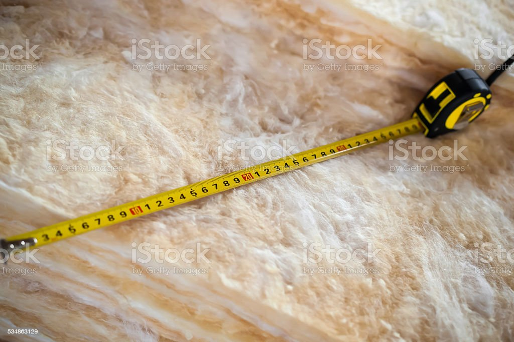 Measure tape on mineral wool stock photo
