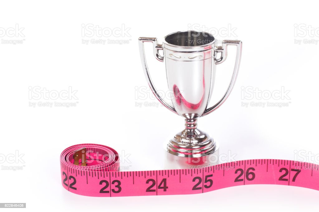 Measure tape roll and sports cup stock photo