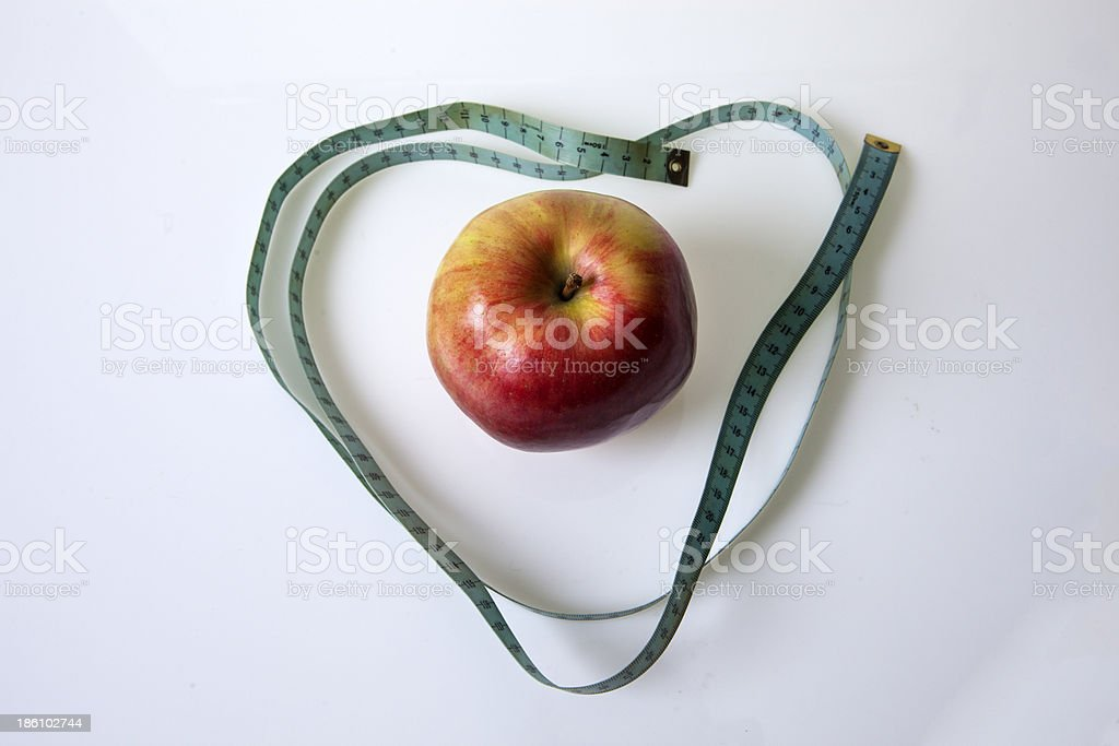 Measure the length and apple royalty-free stock photo
